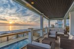 Take in the sunset views off the furnished outside deck