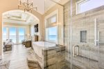 Take in the breathtaking ocean views and magnificent sunsets from both the shower and soaking tub in the west master bathroom suite on the third floor