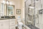 This home features 5 separate custom walk-in showers complete with rain heads.