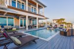 The large pool, complete with 6 jacuzzi jets, sits right outside the door on the 2nd floor main living level.  The views from this deck are nothing short of amazing with clear views of both the city and county piers.