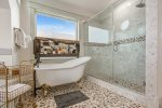 Relax in the claw tub in the master suite