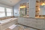 Separate tub in master suite for ultimate relaxation