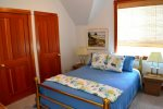 Upstairs Bedroom with Two Bunk Beds at Saltwater Snug