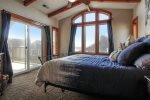 Master bedroom with upper deck access at Rhythm of the Tides