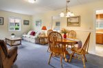 Living and dining areas at Cozy Cottage