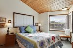 Upstairs bedroom with Queen bed at The Puffin`s Nest