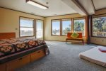 Large third bedroom and playroom with door to the lower deck at The Puffin`s Nest