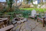 Fire pit and seating at Baker Beach Cottage