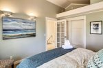 Upstairs bedroom with queen bed at Baker Beach Cottage