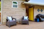 Back Deck  with seating and BBQ at Lil` Bird Cottage