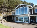 Ocean View Windows, large deck and expansive patio area at Cove Beach Lodge