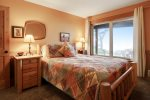 3rd bedroom, downstairs with queen bed and ocean views at Cove Beach Lodge