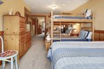 4th bedroom, downstairs, with queen bed and 2 sets of bunk beds at Cove Beach Lodge