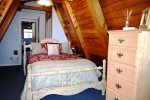 Upstairs Bedroom with queen bed and attached bathroom at Ecola Haven