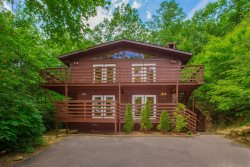 Gatlinburg Chalet offers three bedrooms, two baths, wood burning fireplaces with Seasonal access to Chalet Village Owners Club