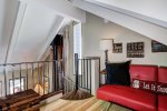 Loft above main living space, red futon, and queen aerobed available