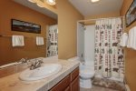 Main level guest bathroom, tub/shower combo, linen closet