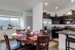 Fully equipped kitchen, dining area seats 4, breakfast bar seats 2.