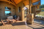 Deck off the kitchen and dining area, steps to access the lower patio and hot tub