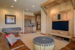 Downstairs family room, flat screen TV with satellite, fooseball table and wet bar