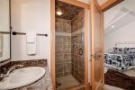 Guest bedroom en suite, standing shower and large jetted tub