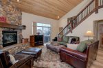 Main living space. Wood fireplace. Access to private hot tub. Open floor plan.