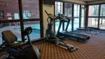 The work out room is right next to the pool atrium.
