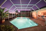 Vacanza Rentals - Villa Macallan pool area by night