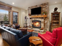 High-end ski-in/ski-out condo with fireplace, ski storage, outdoor pool and community hot tubs.