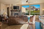 The living area has charming southwestern inspired interiors and stunning Sedona red rock views