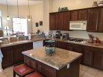 There is plenty of granite counter space to prep meals and entertain guests