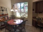A dining table in the kitchen with a laptop friendly workspace is a sunny spot for plan your Sedona activities