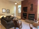 There is a cozy gas fireplace for cooler evenings and a flat screen TV for entertainment