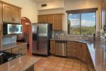 The kitchen is every chef`s dream with modern stainless steel appliances and granite countertops