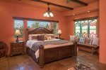 The master bedroom is elegant with a king size bed