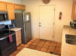 The kitchen is well-equipped with modern appliances and amenities