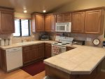 The open plan kitchen is spacious with modern appliances and amenities