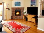 A wood-burning fireplace adds warmth in the cooler months with a flat screen TV for entertainment