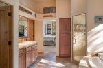 A view of the master bathroom looking towards the bedroom