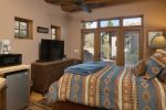 There is a separate Casita in the center of the home with a queen bed, kitchenette and private bathroom