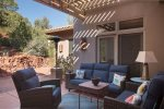 A covered outdoor seating area links the Casita with the main home