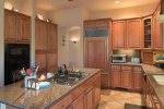 The kitchen is fabulously appointed with modern appliances and amenities