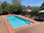 The living area is luxurious with Saltillo tiles, modern interiors, a cozy gas fireplace and majestic red rock views