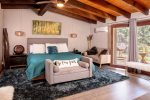 The upstairs master bedroom is modern with turquoise accents