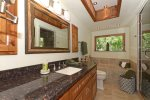 The master bathroom has granite counters, a bath and walk-in shower