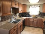 Kitchen amenities include a Refrigerator, Electric Stove, Coffee Maker, Microwave, Toaster, Cookware and Dishwasher