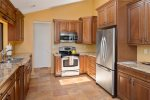 The kitchen is spacious and fully-equipped with modern appliances and amenities