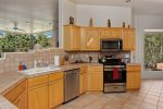 The upgraded kitchen has high-end appliances and upgraded kitchen amenities