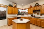 The kitchen is fully-equipped with modern appliances and amenities