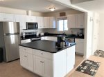 The kitchen is updated with high-end appliances and modern amenities
